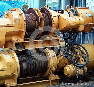 Free Two Large Yellow Winches Royalty Free Stock Photography - 26801597