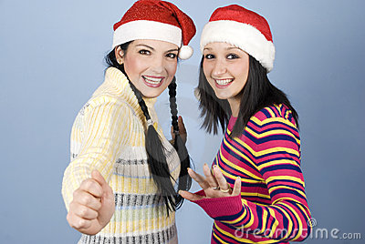 Two laughing girls with Santa hat