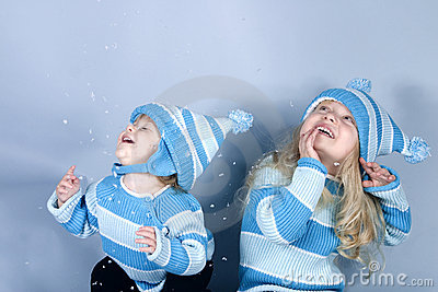 Two laughing girls in snow