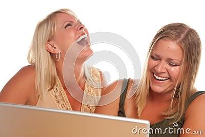 Two Laughing Woman Using Laptop
