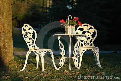 Two Lawn Chairs and a Table Outdoors