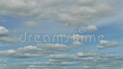 Two levels of white clouds move by blue sky at sunny day. Time lapse stock video