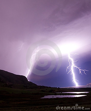 Two lightning bolts reflecting in water