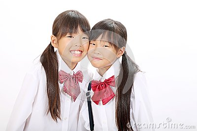 Two little asian schoolgirls
