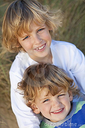 Two Little Boys, Brothers, on A Sunny Beach