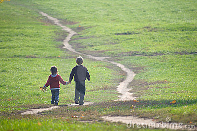 Two little boys following the path