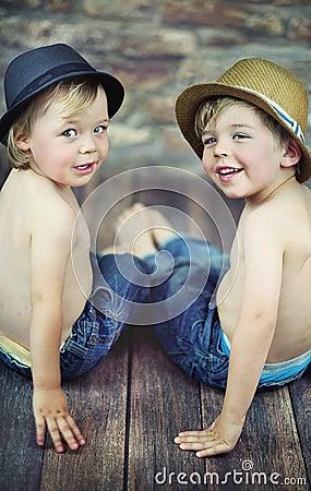 Two little boys sitting