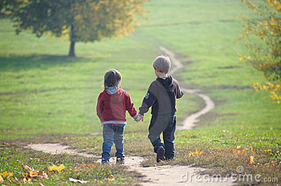 Two Little Boys Walking On The Path Royalty Free Stock