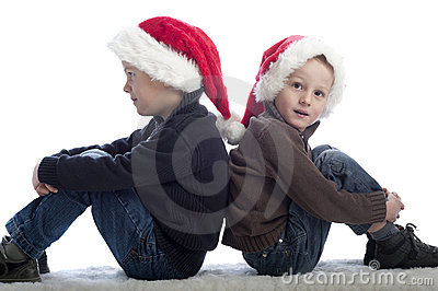 Two little boys with xmas hats