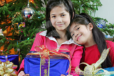 Two little girls with Christmas presents
