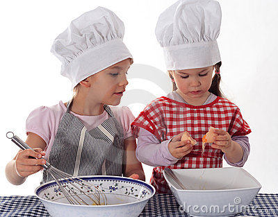 Two little girls in the cook costume