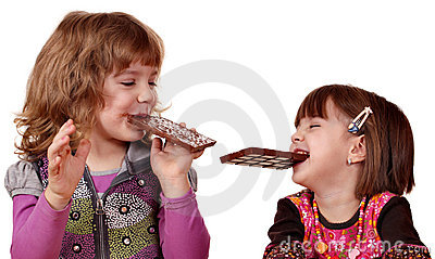 Two little girls eating chocolate