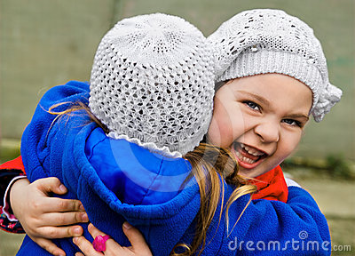 Two little girls embracing each other