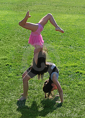 Two little girls exercising