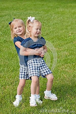 Two Little girls hugging