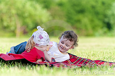 Two little girls playing in the field