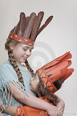 Two little girls playing Indians