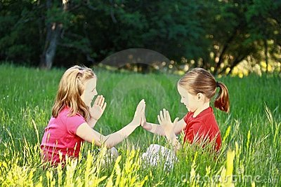 Two Little Girls Playing Patty Cake Royalty Free Stock
