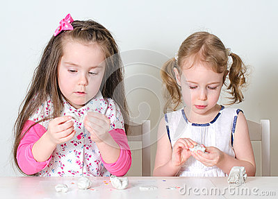 Two little girls sculpting