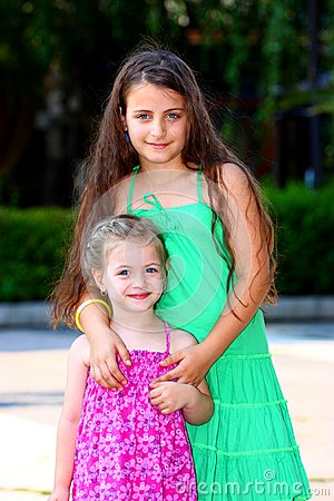 Two little girls ( sisters )