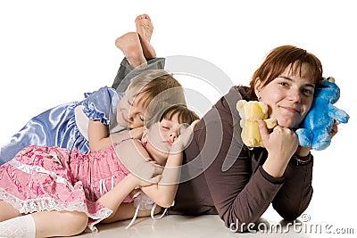 Two little girls sleeping on mum