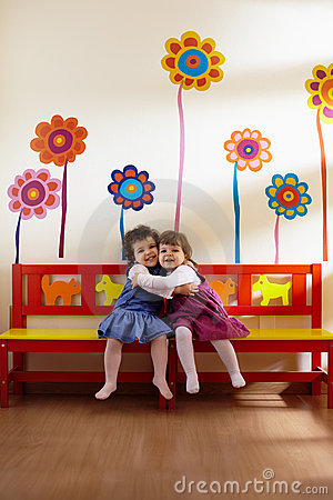 Free Two Little Girls Smile And Hug At School Royalty Free Stock Image - 19001886