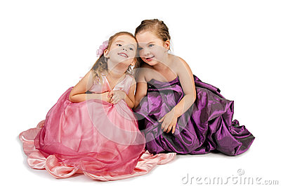 Two little girls speaking with each other