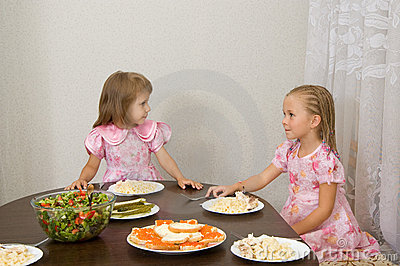 Two little girls at the table