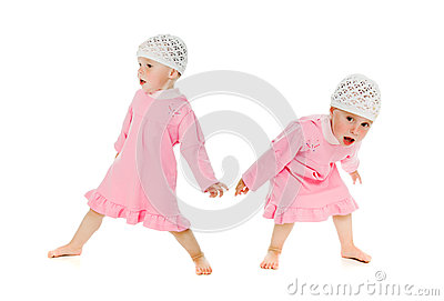Two little girls twins restless