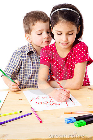 Two little kids draw for mum