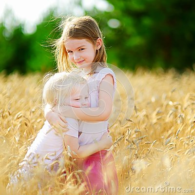 Free Two Little Sisters In Wheat Field On Summer Day Royalty Free Stock Photography - 48392207