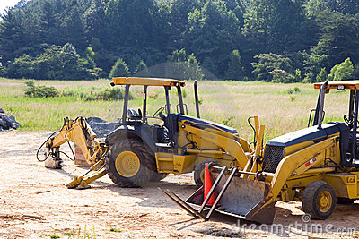 Two Loaders in a Field