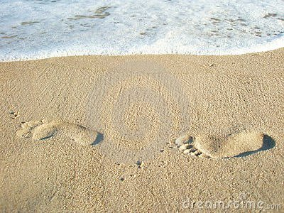Two lonely footprints in the sand