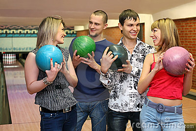 Two in lovers couple stand with balls for bowling