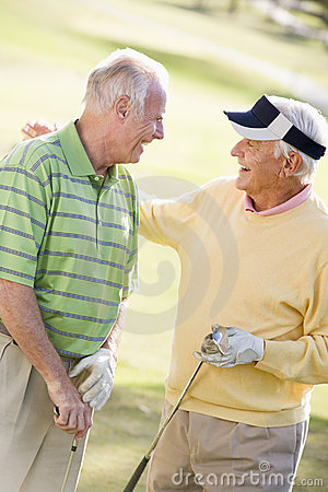 Two Male Friends Enjoying Game Of Golf