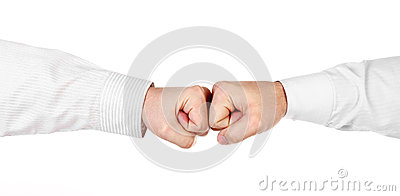Two male hands in shirt as fists together isolated