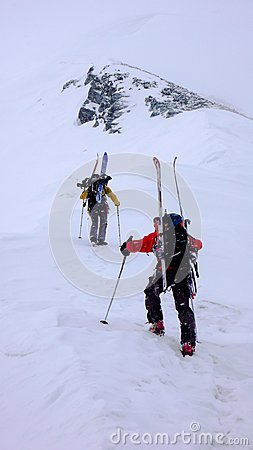 Free Two Male Mountain Climbers On A Backcountry Ski Mountaineering Tour In Bad Weather Stock Photography - 113613562