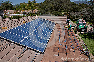 Two male solar workers install solar panels Editorial Stock Image