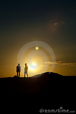 Two man at sunset