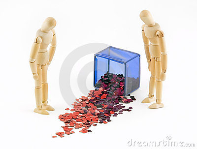 Two Mannequins Look at Spilled Box of Hearts