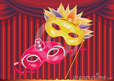Two masks on red curtain background