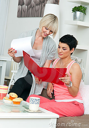 Free Two Mature Woman Friends Working At Home Stock Photography - 19890252