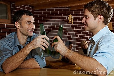 Two men drinking beer in bar