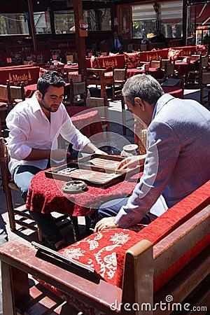 Free Two Men Enjoying A Game Of Backgammon Stock Photography - 42228892