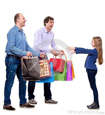 Two men giving shopping bags to a girl
