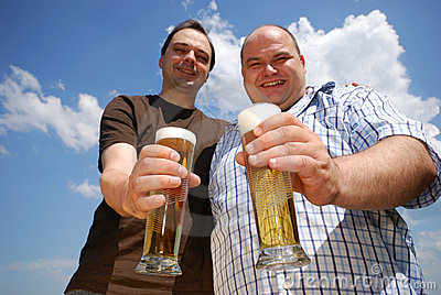 Two men holding beer