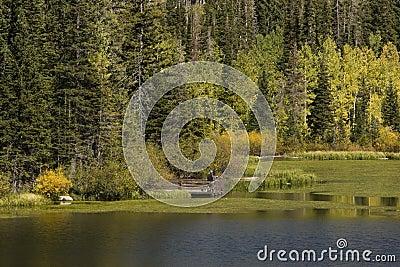 Two men at lake in Autumn