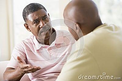 Two men in living room talking