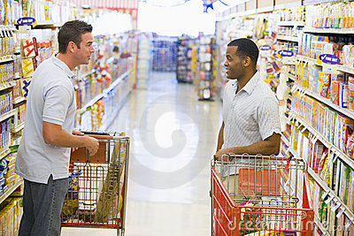 Two men meeting in supermarket