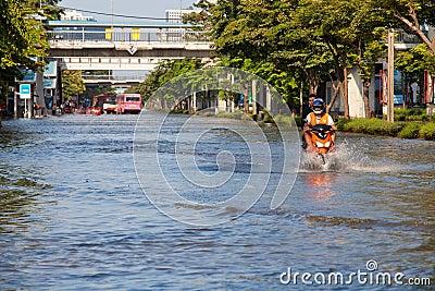 Two men on a motorbike navigating through Editorial Photo